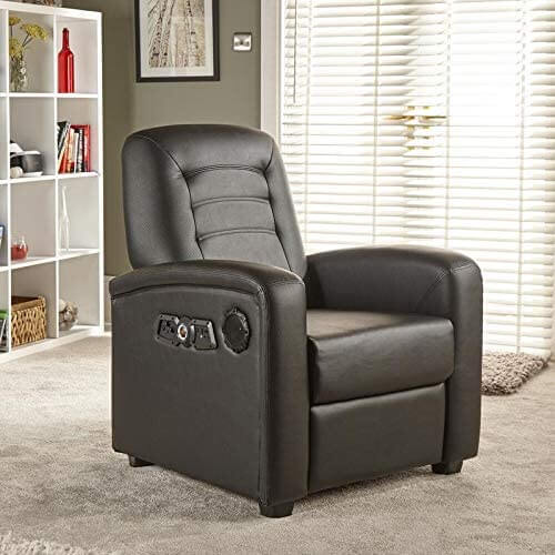 X Rocker playing video games Chair Recliner with the dual Sound speakers And Footrest